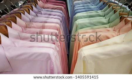 apparel,background,banner,blue,boutique,cloth,clothes,clothes shop,clothing,coat hanger,collection,color,colorful,cotton,department store,discount,dress,fabric,fashion,formal shirt,garment,gentle,gent #1405591415