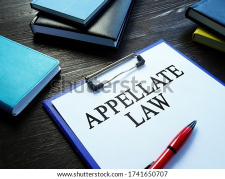 Appellate law, pen and notepads on the desk. Photo stock ©