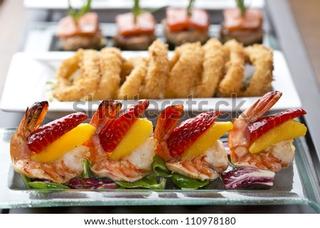 appetizer food or tapas / delicious side dish with shrimp, strawberry and mango