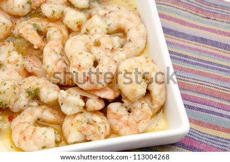 Appetizer of shrimp cooked with garlic sauce