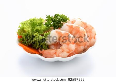 Appetizer of shrimp served on a bed of lettuce