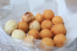 Appetizer Thailand ancient has a nickname called turtle eggs made by sweet potatoes mix wheat flour then frying oil.