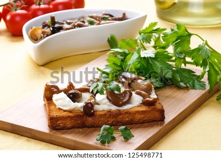 Appetizer : toast with mushroom , cheese and parsley