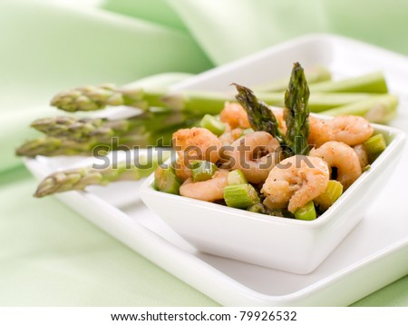 Appetizer with baked shrimp and asparagus. Selective focus, shallow depth