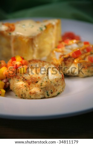Appetizer with Crab Cakes, Cream Sauce, Cheese