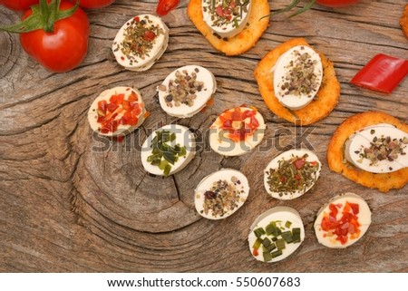 appetizers cheese and bruschetta with herbs, tomato and chilli peppers,Vegetarian starter appetizer