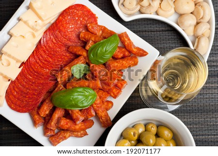 Appetizers set with salami, cheese, mushrooms, olives and kabanos Photo stock ©
