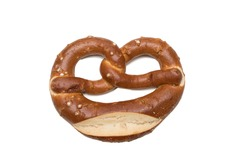 Appetizing Bavarian pretzel isolated on white background. Bavarian traditional bread, a symbol of Germany, cultural and culinary traditions. Close-up photo