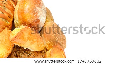 Photo of Appetizing breads and buns isolated on a white background. Free space for text. Wide photo.