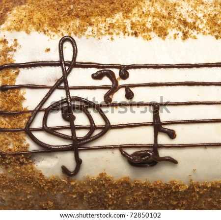 appetizing cake with treble clef drawing by cream