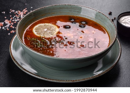 Appetizing dish of russian hodgepodge soup in ceramic pot