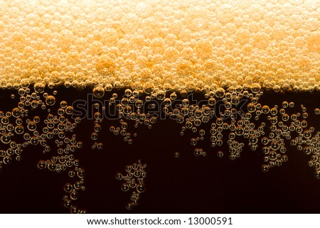 appetizing filtered dark beer with foam