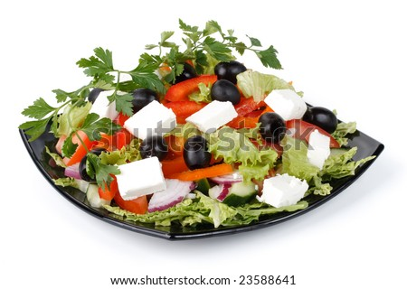 Appetizing greek salad on a plate. Close up.