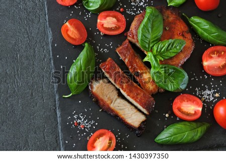 Appetizing meat steak on a stone board with basil and tomatoes. Keto diet. Pegan Diet. Paleo diet. #1430397350