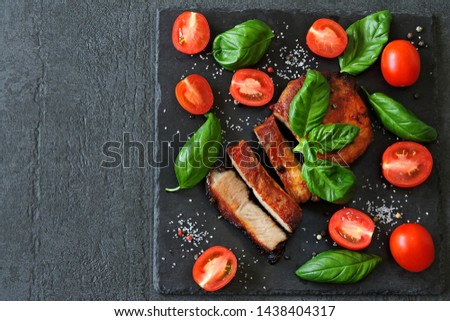 Appetizing meat steak with tomatoes and basil. Keto diet. Paleo diet. Pegan Diet.