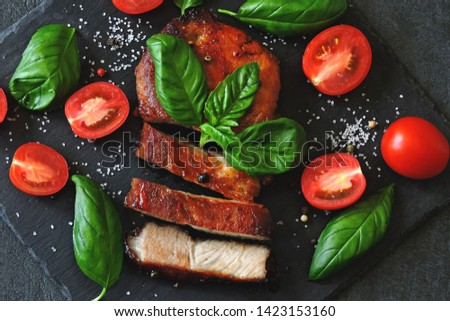 Appetizing meat steak with tomatoes and basil on a stone board. Balanced nutrition concept. Paleo diet. Pegan Diet. #1423153160