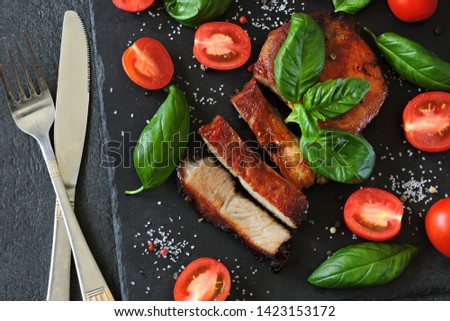 Appetizing meat steak with tomatoes and basil on a stone board. Balanced nutrition concept. Paleo diet. Pegan Diet. #1423153172