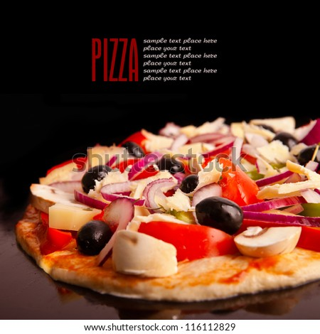 Appetizing pizza with mushrooms isolated on black