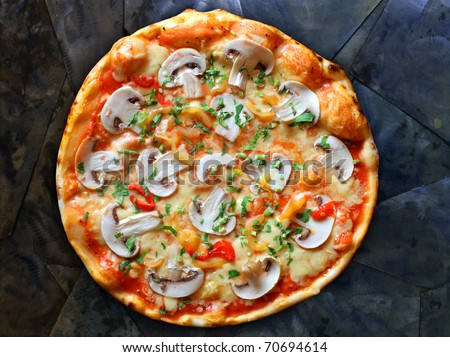 Appetizing pizza with mushrooms on a stone