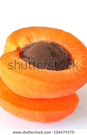 appetizing ripe orange apricot closeup macro over white background