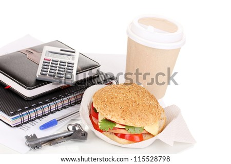 Appetizing sandwich with with office supplies isolated on white