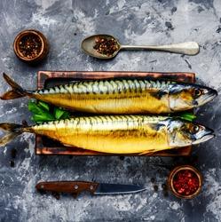 Appetizing smoked fish on kitchen board.Smoked mackerel
