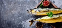 Appetizing smoked fish on kitchen board.Smoked mackerel.Mediterranean food