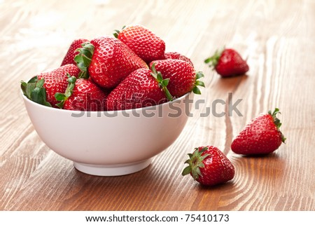 Appetizing strawberry in the bowl. Isolated on a white background.
