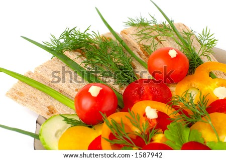 Appetizing vegetable salad and loves of healthy bread isolated on white background