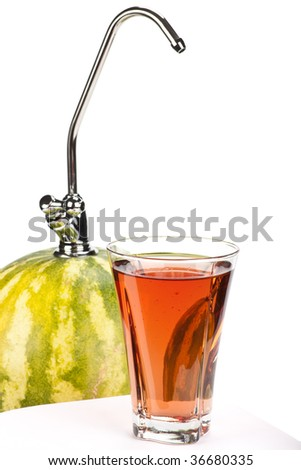 Appetizing water-melon with a tapping cock and a glass of fresh juice over white background