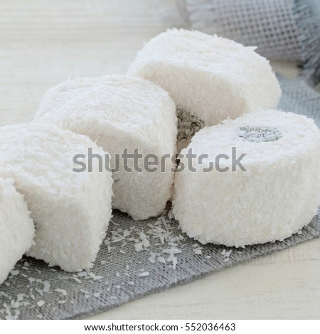 appetizing white rahat-lokum in a coconut crumb #552036463