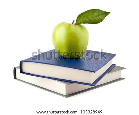 Apple and books on a white background