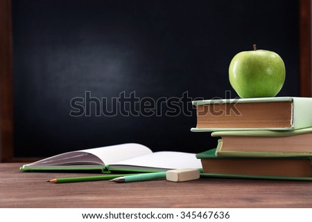 apple and books on desk...