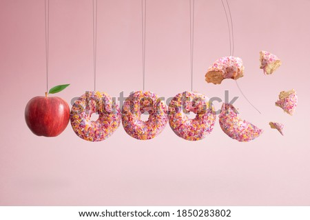Apple and dougnuts collision balls diet cravings concept Сток-фото ©