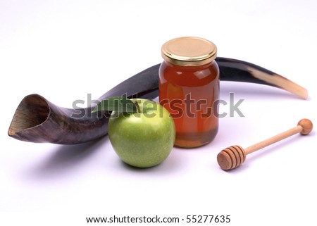 Apple and honey - a snack eaten by jews in Rosh Hashana..Shofar - A horn used in the jewish holidays of Rosh Hashana and Yom Kippur.