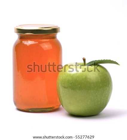 Apple and honey, isolated. A snack eaten by jews in the holiday of Rosh Hashana