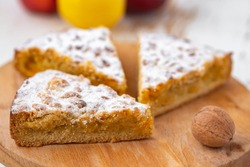 apple and nuts pie on woodenbackground
