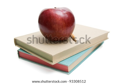 Apple and pencil on a stack of books