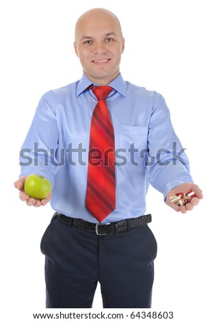 Apple and pills in the hands of a businessman. Isolated on white background