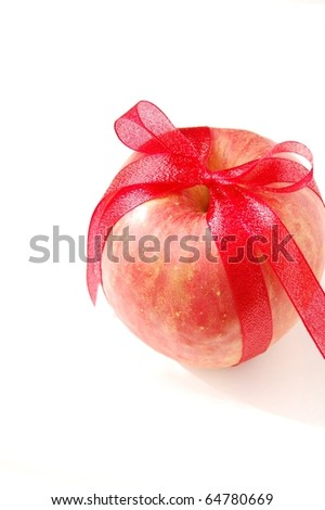 apple and red ribbon bow