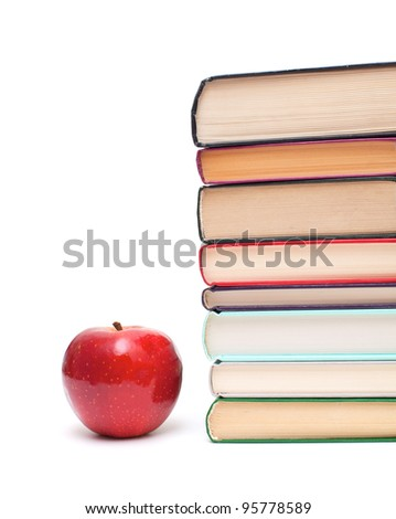 apple and stack of books isolated on white