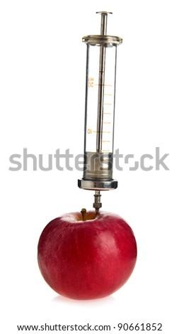 apple and syringe on a white background