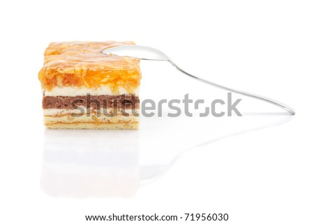 Apple cake with a spoon isolated on white background