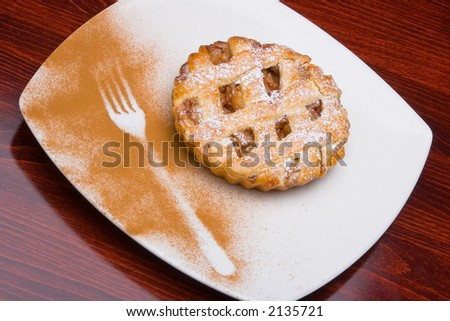 Apple cake with silhouette of holder