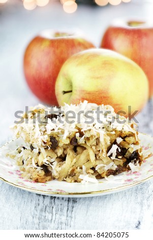 Apple casserole made of shredded apples, oats, coconut and raisins. Shallow depth of field.