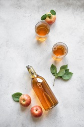 Apple cider drink or fermented fruit drink and organic apples on white, top view, copy space. Healthy eating and lifestyle concept.