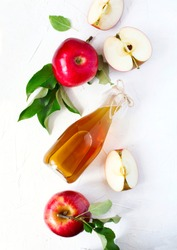Apple cider vinegar and fresh apples, top view