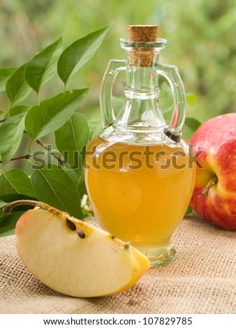 Apple cider vinegar in glass bottle, selective focus