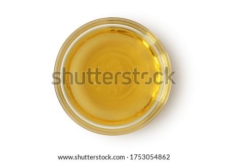 Apple cider vinegar in glass bowl on white background Foto stock ©