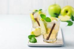 Apple cinnamon kombucha iced cocktail.  Selective focus, space for text.